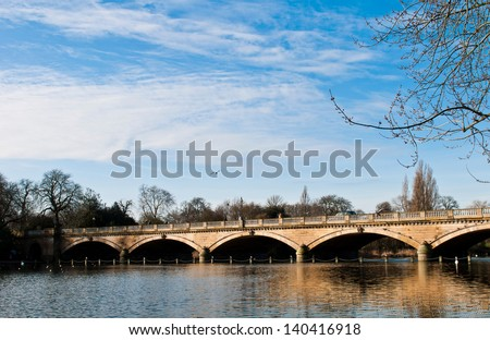 Serpentine bridge and lake in Hyde Park in London, England - stock photo