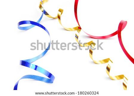 serpentine confetti isolated in white - stock photo