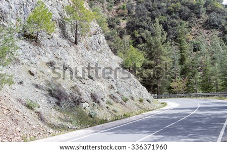 Serpentine highway turn with pines on slope. Cyprus.  - stock photo