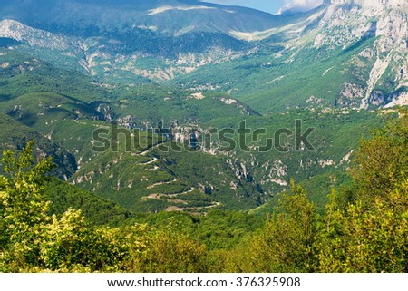 serpentine road. road in the Vikos Gorge, Greece - stock photo