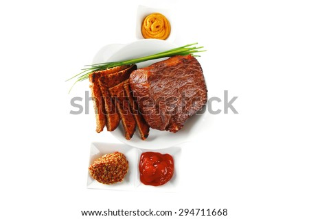 served beef meat fillet mignon with spices and toasted bread isolated on white background - stock photo