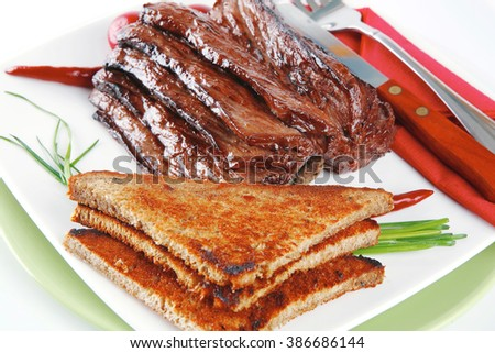 served beef with dishware on white dish - stock photo
