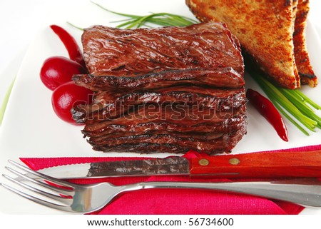 served cutted meat with bread and dishware - stock photo