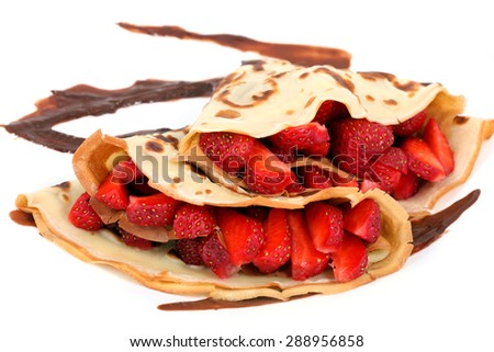 served dessert: isolated pancakes with strawberry and chocolate