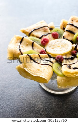 Served flapjack pancakes with chocolate and fruits,selective focus - stock photo