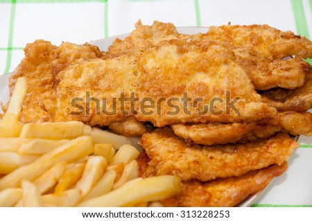 Served fried chicken breast and french fries.