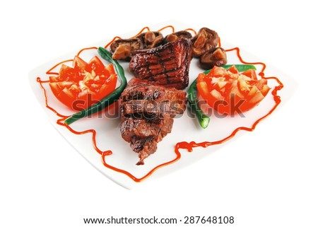 served grilled beef fillet mignon entrecote on a white plate with mushrooms and tomatoes on plate isolated on white background - stock photo