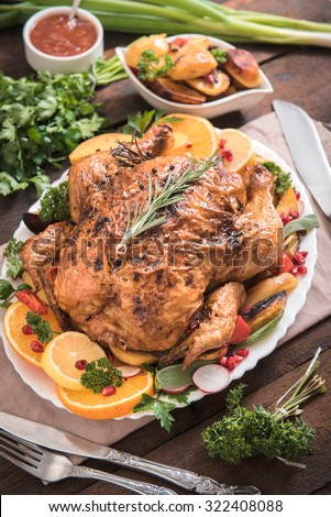 Served holidays dinner with split roasted turkey and vegetables on plate,selective focus - stock photo