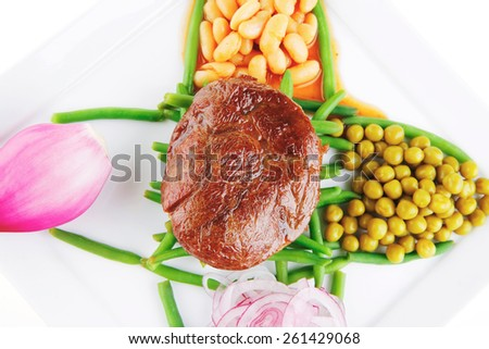 served meat medalion on green beans with vegetables - stock photo