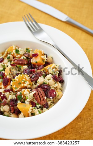 served portion of vegetarian salad with couscous and pumpkin