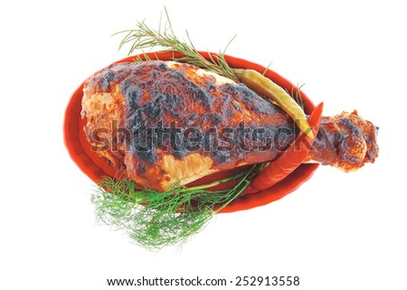 served roast chicken leg with greenery on white - stock photo