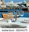 served table at restaurant of barcelona on sea quay in Port Vell - stock photo