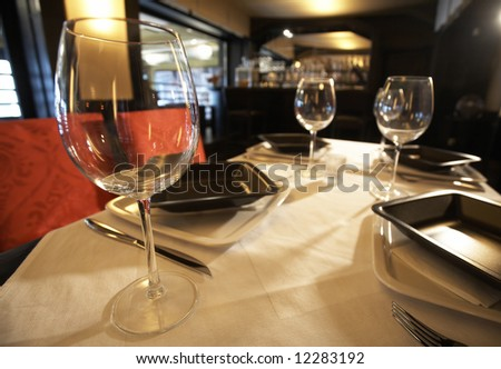 Served table at the restaurant in front of the bar - stock photo