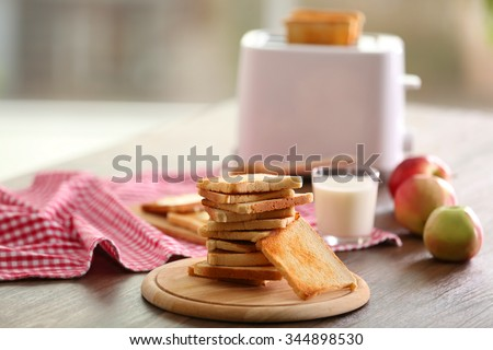 Served table for breakfast with toast, milk and honey, on blurred background - stock photo