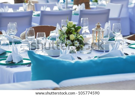 Served table in a luxury outdoor restaurant. Shallow depth of field. - stock photo