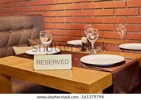 Served table in cafe with walls of red bricks - stock photo