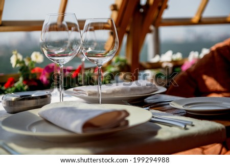 served table on the veranda in a luxury restaurant - stock photo