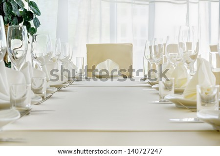 Served table with dishes and glasses.