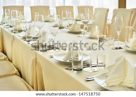 Served table with dishes and glasses. - stock photo