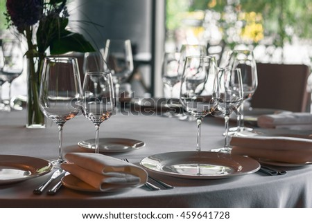 served table with glasses and dishes