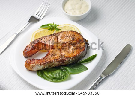 Served Table with Grilled Salmon Steak.