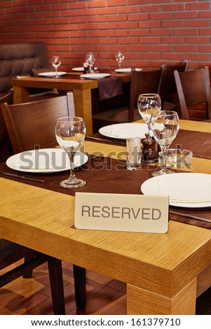 Served table with sign Reserved in restaurant - stock photo