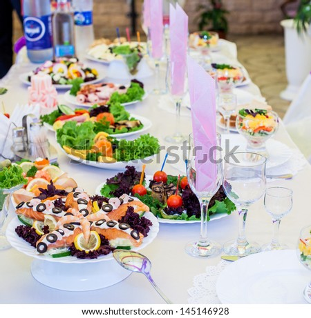 Served table with snacks - stock photo