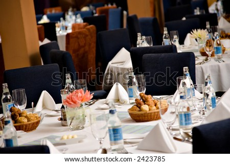 Served table, with water, ready for event - stock photo