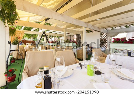 Served tables at summer terrace cafe  - stock photo