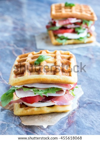 Served waffle sandwiches with prosciutto,selective focus - stock photo