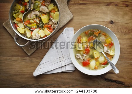 Served warm stew with vegetables and meat on the plate - stock photo