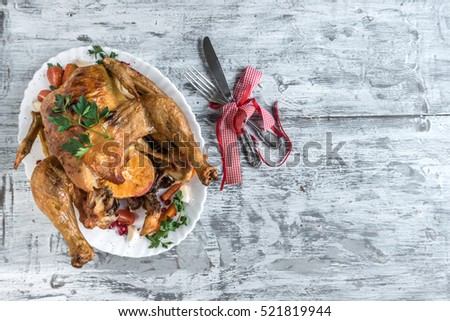 Served whole roasted chicken with vegetables on the table