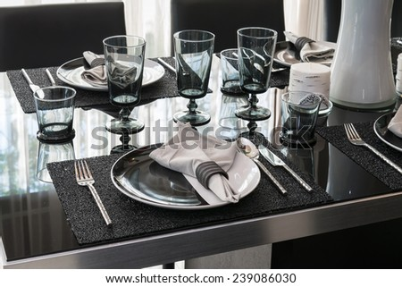 served with a plate on  black table in modern  dinning room - stock photo