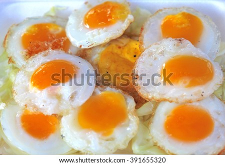 Served with fried quail egg - stock photo