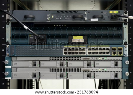 Server computer and power on ethernet switch install on rack in data center room.