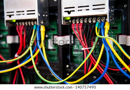 Server front side showing colorful switches and wiring. - stock photo