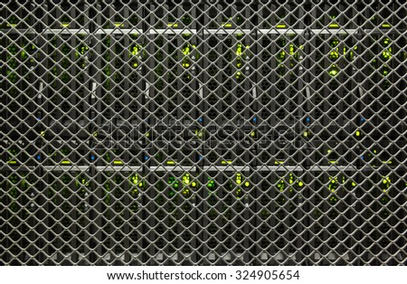 server hardware and the lights through a grid of server racks in the data center - stock photo