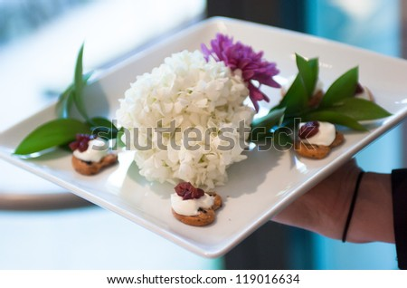 Server holding a tray of appetizers at a banquet - stock photo