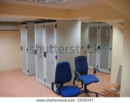 Server racks in server room (image contains noise) - stock photo