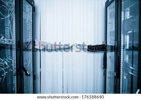 server room and data center, Network Engineer transmits console cable - stock photo