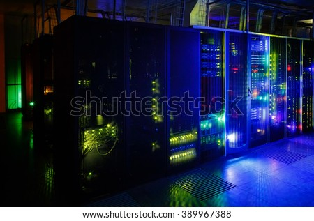 server room in the dark, with bright colored lights - stock photo