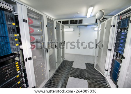 Server room with gray cabinets - stock photo