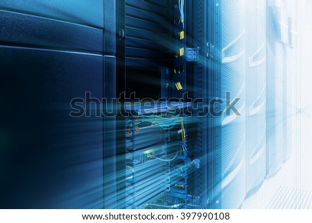 server room with rows of modern mainframes - stock photo