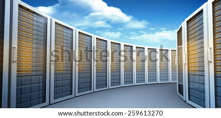 Server towers against bright blue sky with clouds