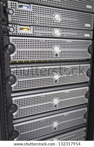 Servers and SAN. This enclosure is a SAN (storage area network). Shot in a data center. Hard drives. - stock photo
