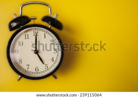 service alarm clock arrow hour minute second black yellow office stationery - stock photo