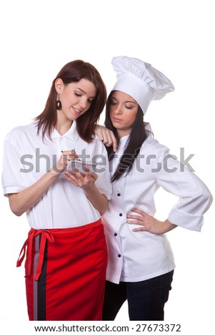 Service and cook together to discuss the menu - stock photo