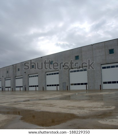 Service bay doors in a newly constructed commercial building made of largely prefabricated materials - stock photo