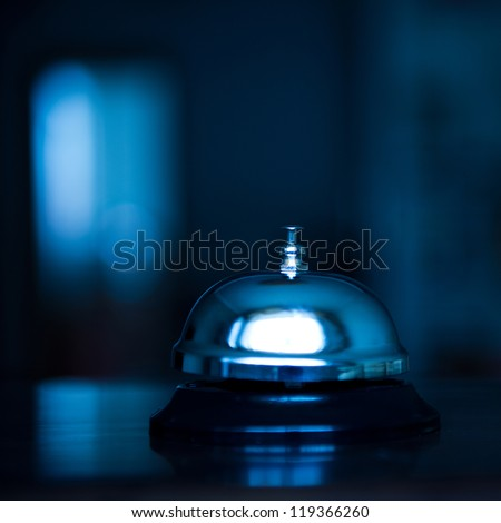 Service bell at an hotel table. - stock photo