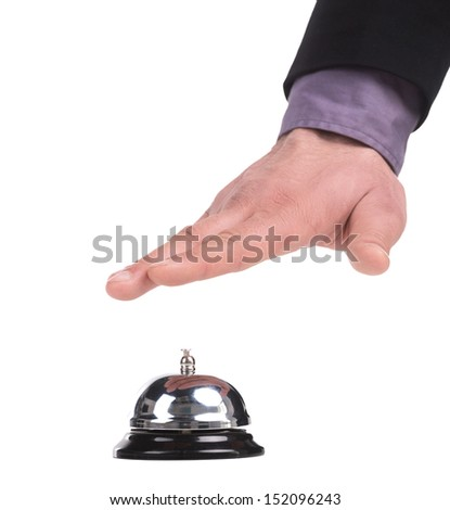 Service bell. Close-up of man holding hand upon the service bell while isolated on white